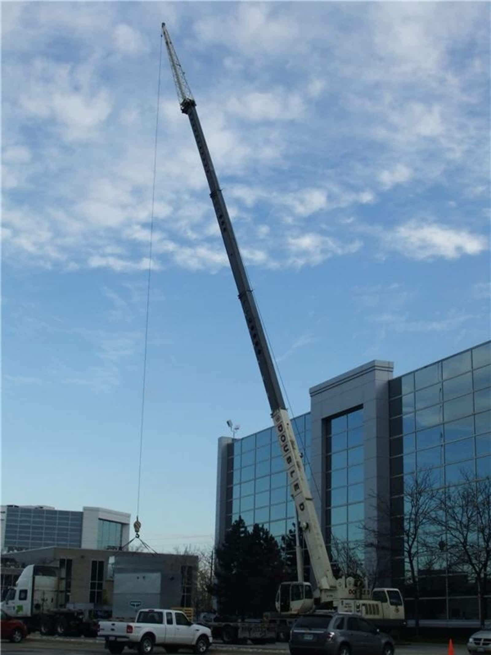 view of a crane lifting a heavy object