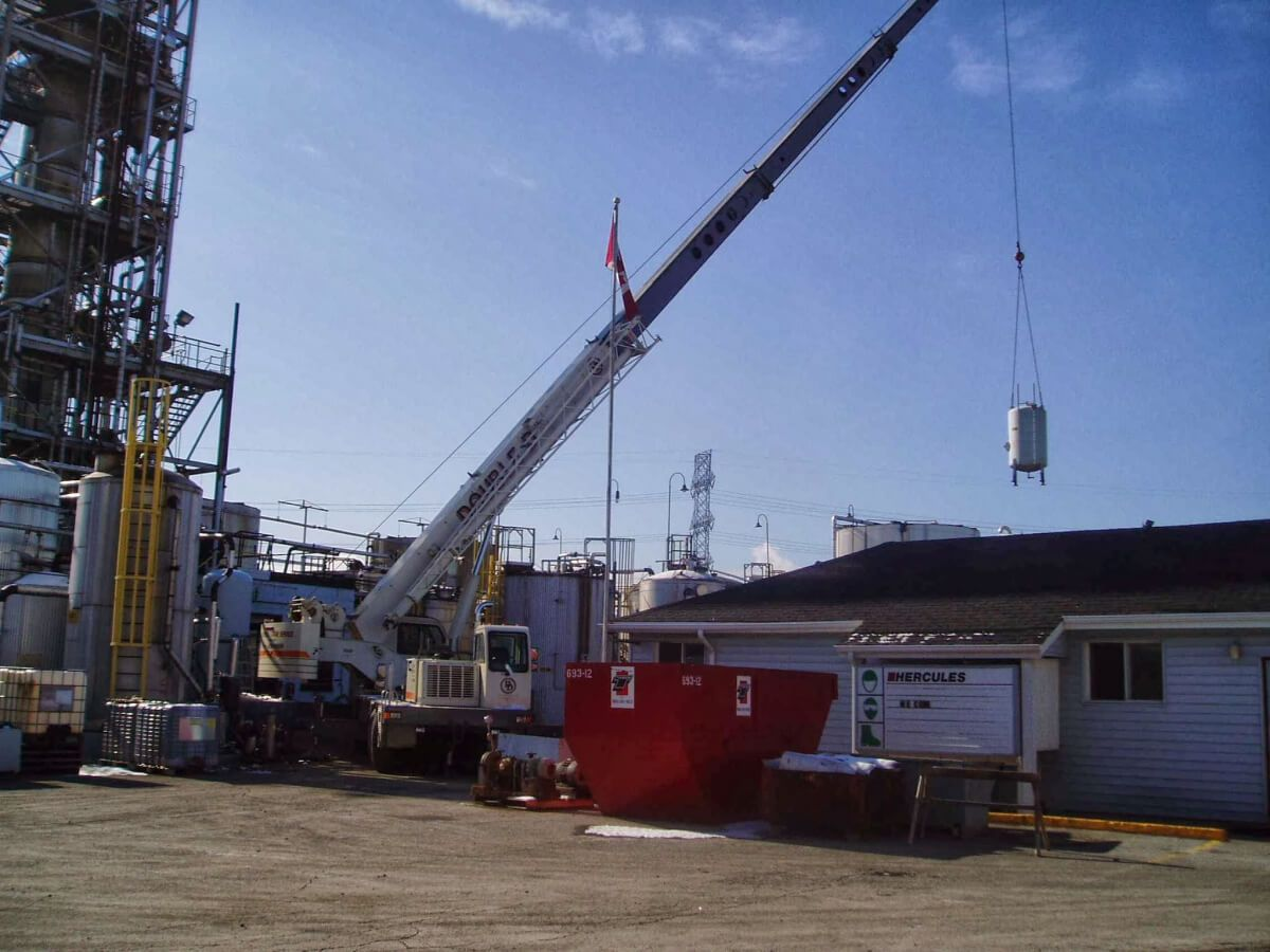 view of a crane installing a object