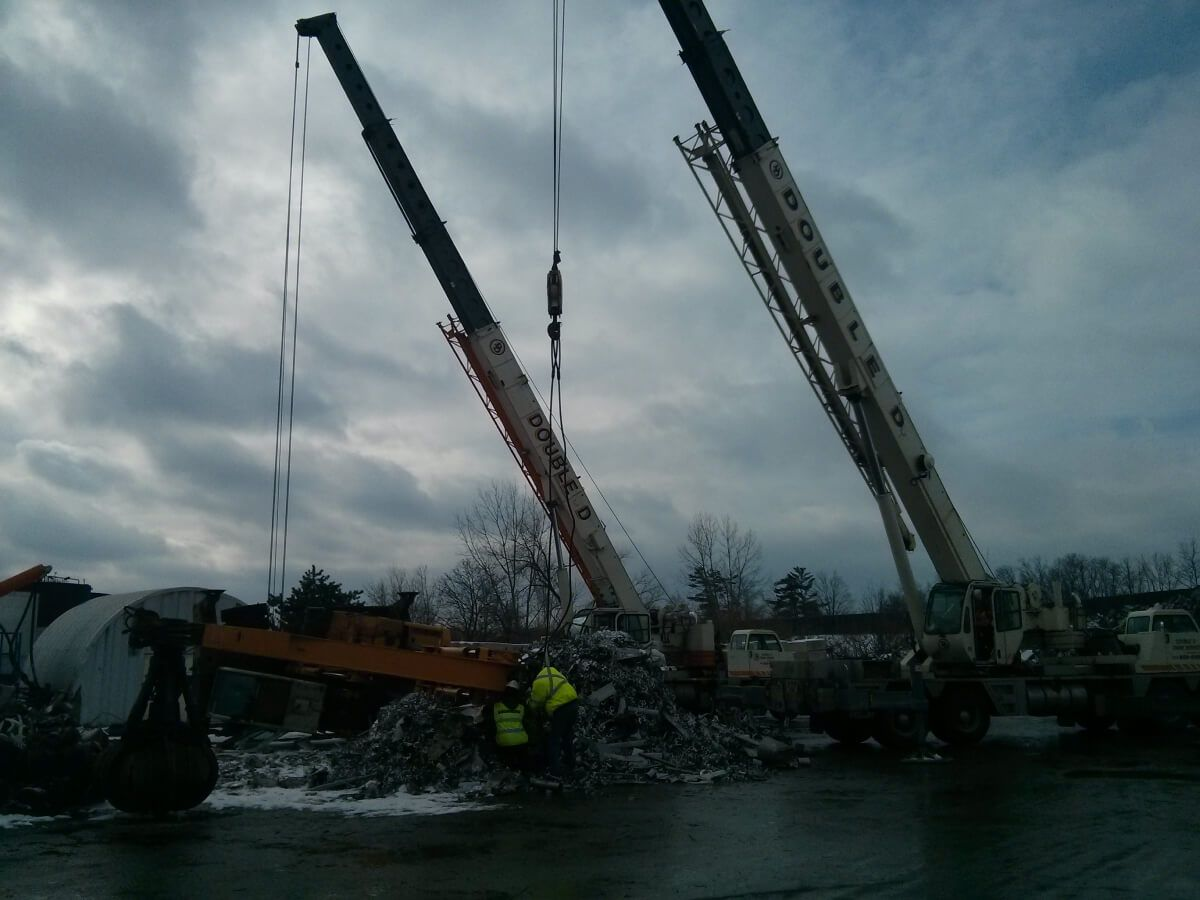 crane lifting heavy object in winters
